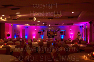 dancefloor at wedding surrounded by led mood lighting with blue and pink colours