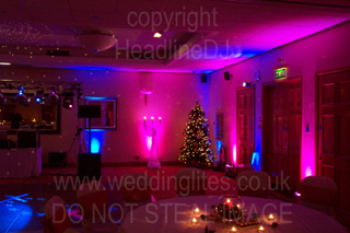 christmas wedding reception with ambient and mood uplighting